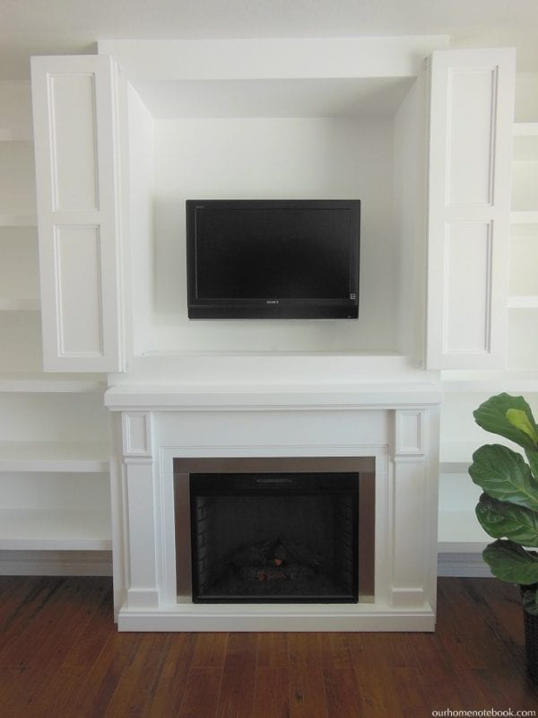 TV Nook Above Fireplace by Our Home Notebook featured on Remodelaholic