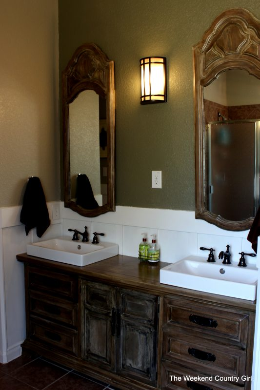 Upcycled dresser and mirrors for bathroom makeover by The Weekend Country Girl featured on @Remodelaholic