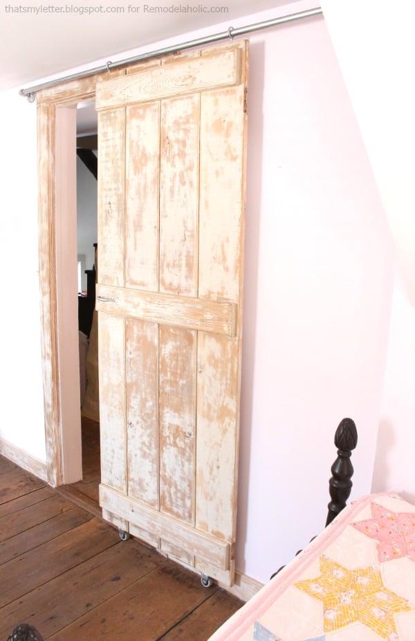 Remodelaholic diy sliding barn door inexpensive hardware for Diy barn door hardware