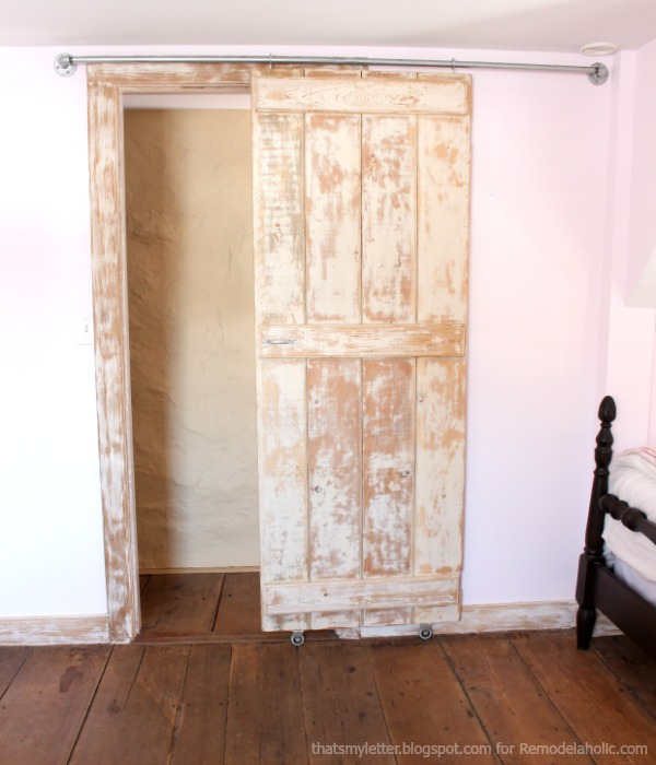 Remodelaholic diy sliding barn door inexpensive hardware for Hanging a sliding barn door