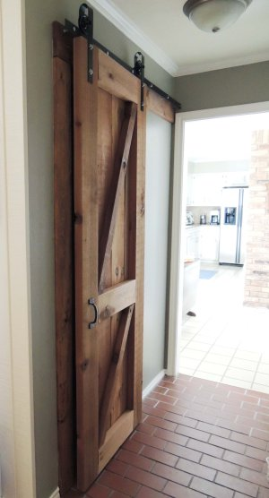 Remodelaholic 35 diy barn doors rolling door hardware ideas build and hang a wooden barn door on diy rolling hardware do or diy solutioingenieria Gallery