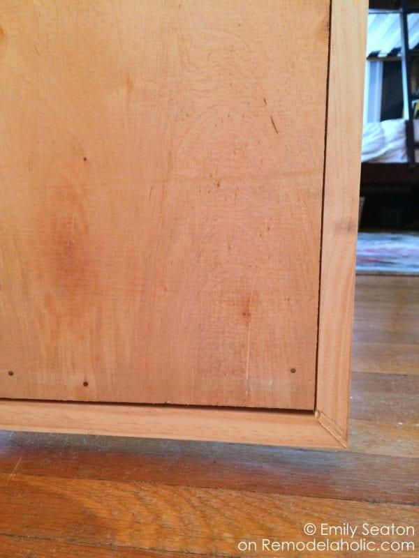 attach wood herringbone barn door back and frame