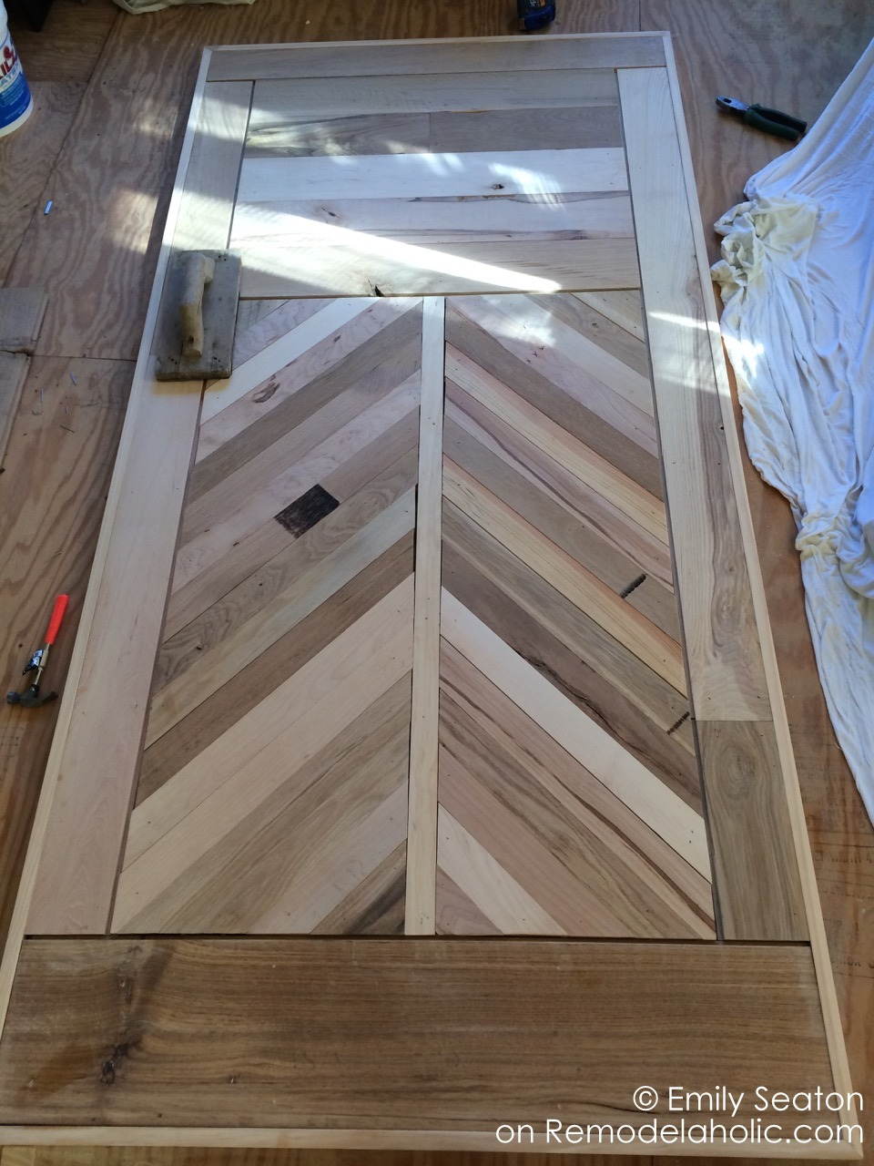 Remodelaholic how to build a wood chevron barn door - How to build a garage cheaply steps ...
