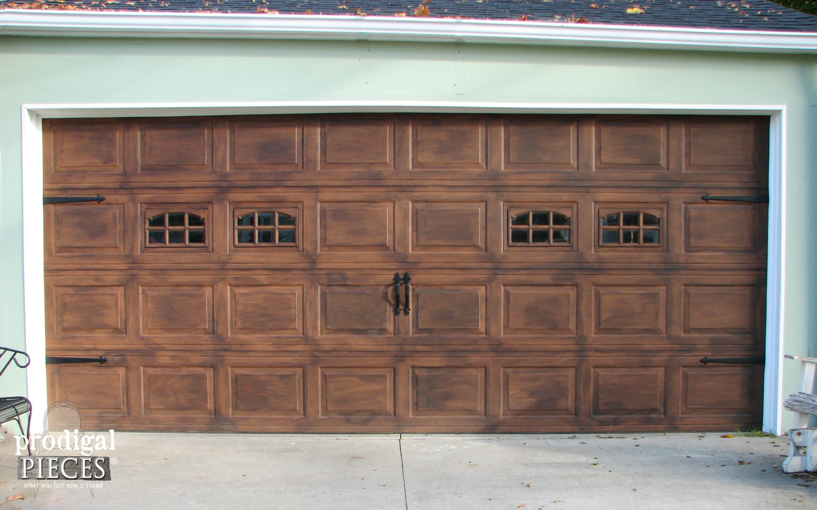 Remodelaholic faux wood carriage garage door tutorial for Wood look steel garage doors