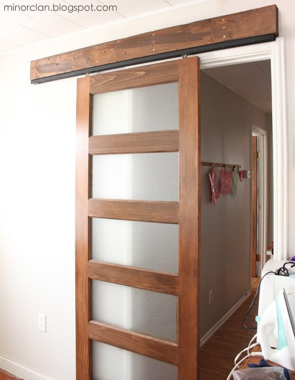 diy sliding barn door using a closet door track via the lettered cottage