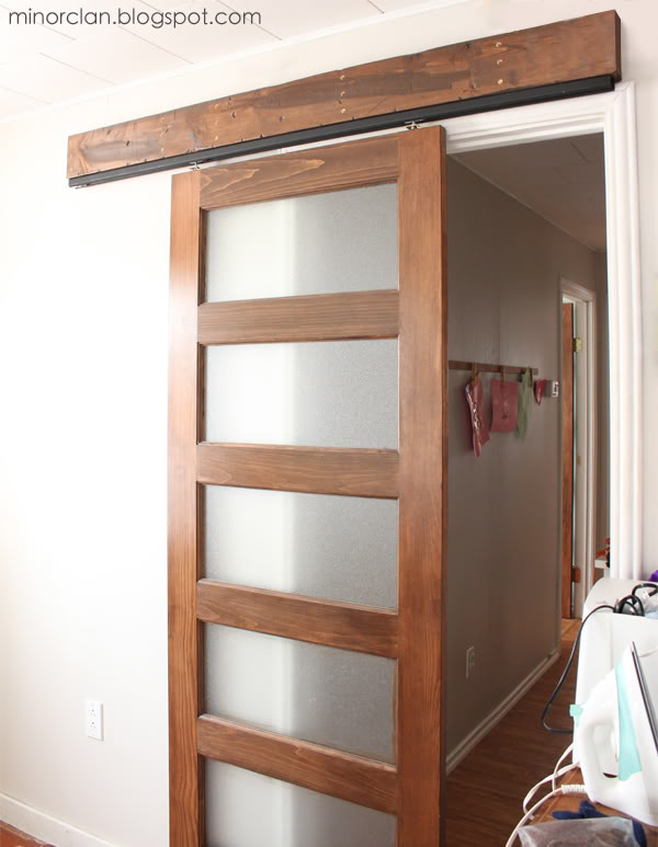 Diy Sliding Barn Door Using A Closet Track Via The Lettered Cottage