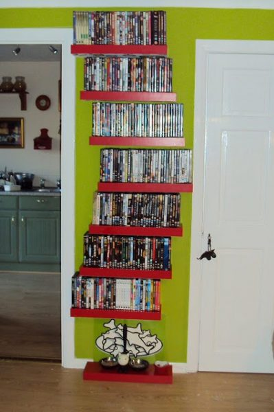 Are you looking for a way to store your DVDs that is organized, efficient, and saves space? Here are 7 smart DVD storage ideas that you'll find useful! via @tipsaholic #dvds #organizing #storage