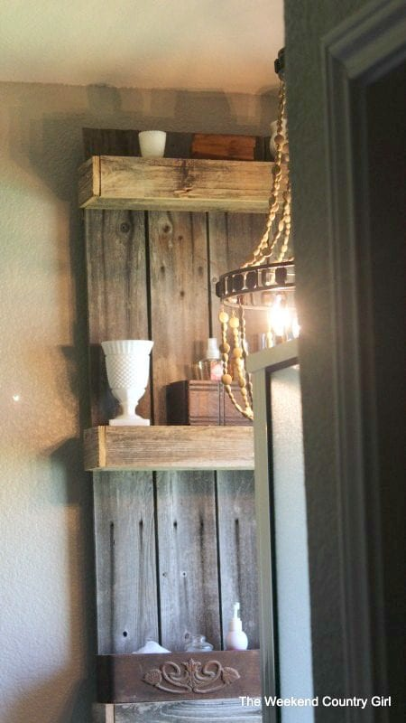 easy bathroom wall shelf by The Weekend Country Girl on @Remodelaholic
