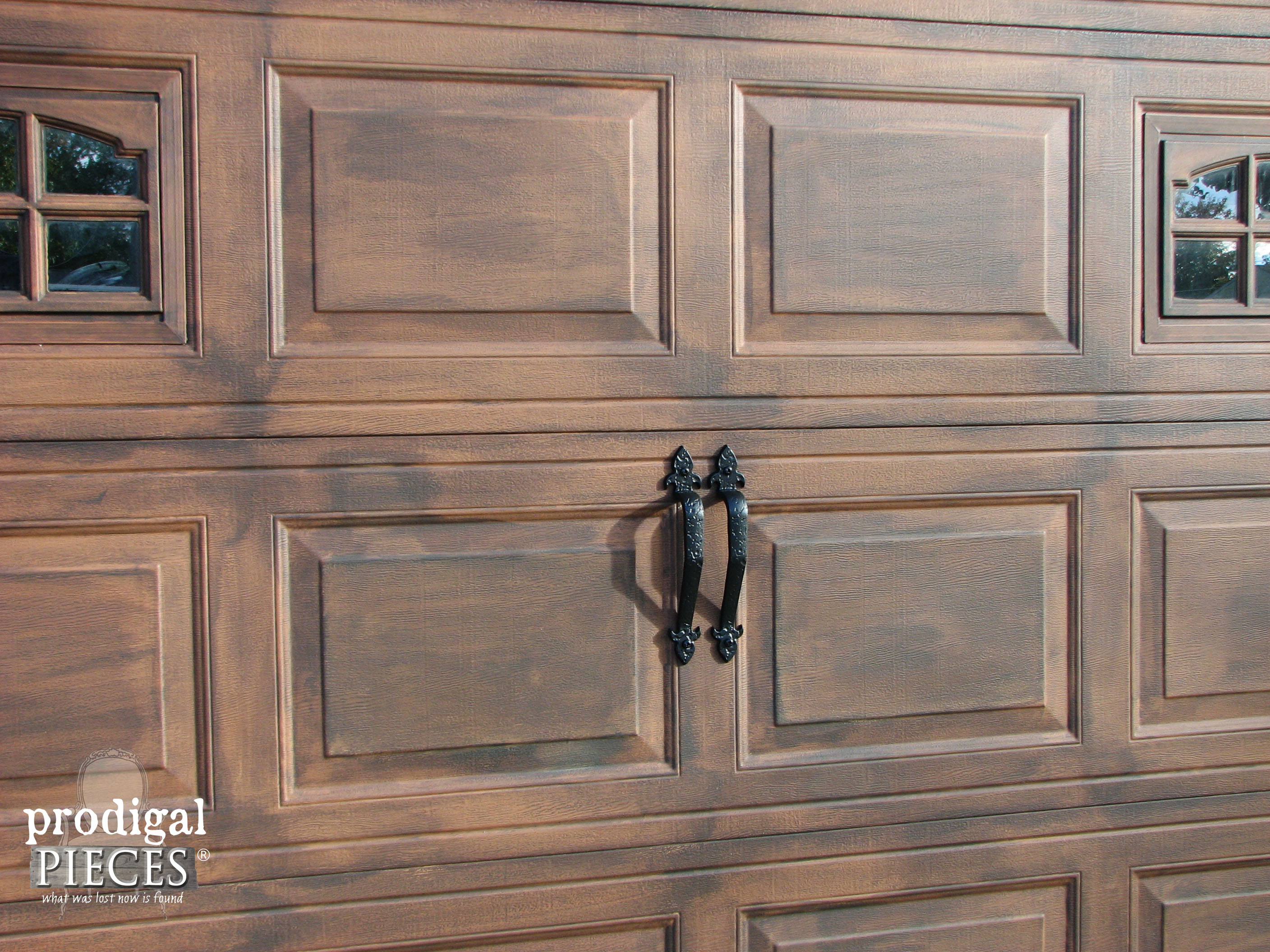 Remodelaholic faux wood carriage garage door tutorial for Faux wood door