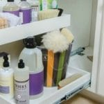 feature Organize Under the Sink -- use a double-decker slide-out organizer for all your cleaning supplies