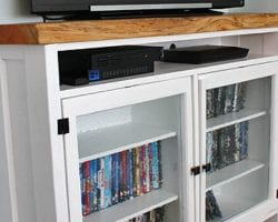 feature tv storage cabinet with old window doors
