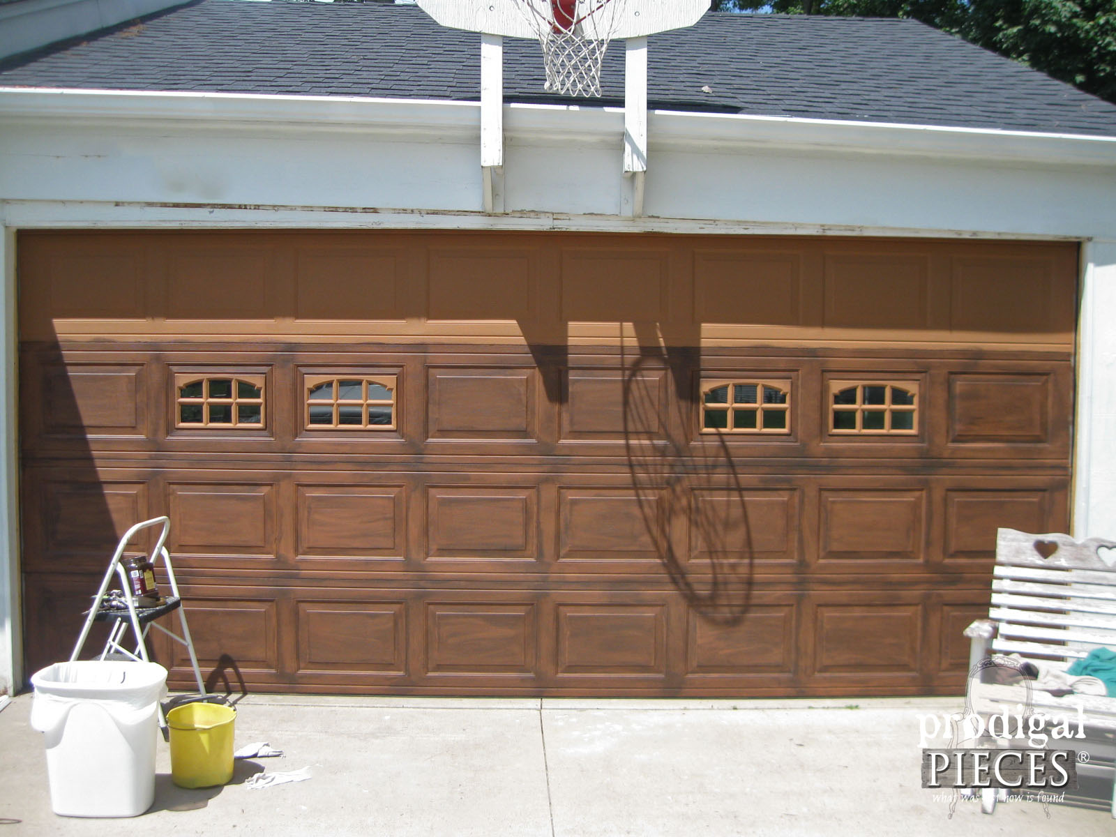 Remodelaholic faux wood carriage garage door tutorial for Faux painted garage doors