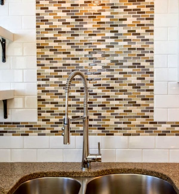 two tone tile and open shelving in updated duplex kitchen - SoPo Cottage on @Remodelaholic