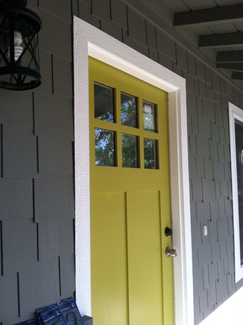 beautiful doors entry door on gray house painted in sherwin williams