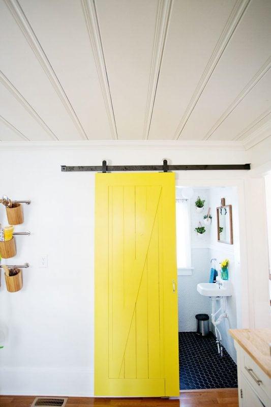 Beautiful Doors - yellow sliding barn door A Beautiful Mess