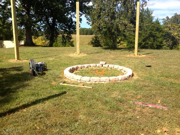 Building a Fire Pit with a Pergola by Little White House Blog featured on @Remodelaholic