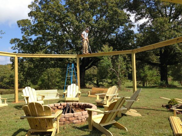 Building a Pergola with a Fire Pit and Adirondack Chairs by Little White House Blog featured on @Remodelaholic