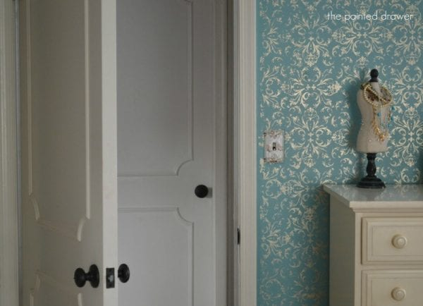 How to Make a Flat Door Look Like a Paneled Door by The Painted Drawer featured on @Remodelaholic
