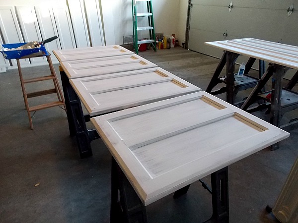 How to paint cabinet doors remodelaholic bloglovin for Best brush for painting kitchen cabinets