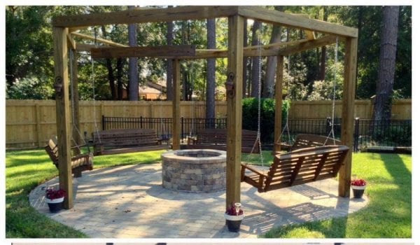 Tutorial for round pergola with fire pit and swings featured on @Remodelaholic