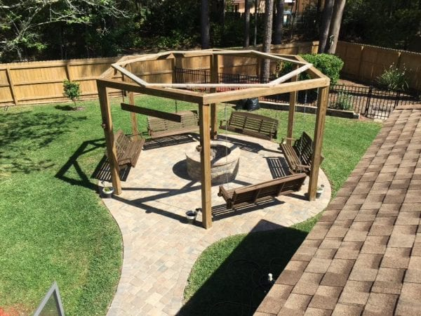 Tutorial for round pergola with swings and fire pit featured on  @Remodelaholic - Remodelaholic Tutorial: Build An Amazing DIY Pergola And Firepit