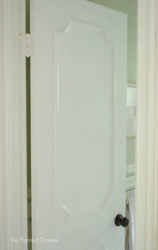 Upgrade a flat door with moulding by The Painted Drawer featured on @Remodelaholic