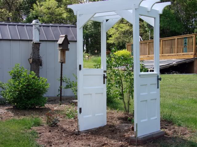 Remodelaholic 100 ways to use old doors for Outdoor decorating with old windows