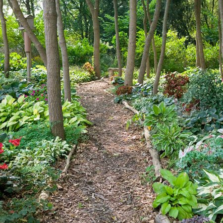 Wood logs make a great natural option for path and garden edges. Increase the beauty of your lawn by adding garden edging that works well with the style and feel of your home. Here are 27 gorgeous garden edging ideas via @Remodelaholic #garden #diy #outdoor #edging