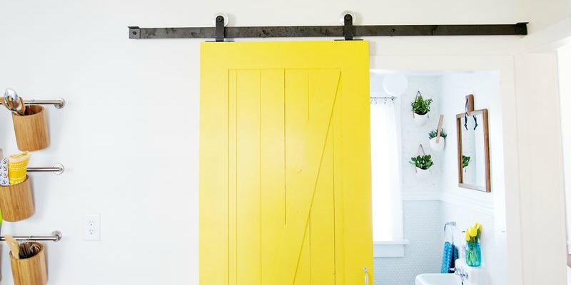 feature Beautiful Doors - yellow sliding barn door A Beautiful Mess