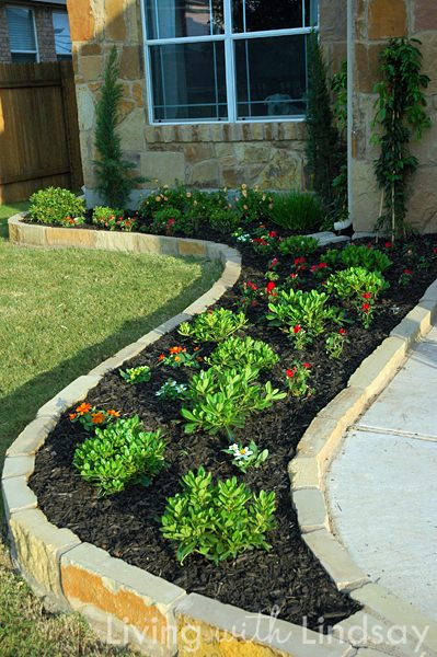 Brick pavers for a tall garden edge and lots of other pretty ways to edge a garden featured on Remodelaholic.com