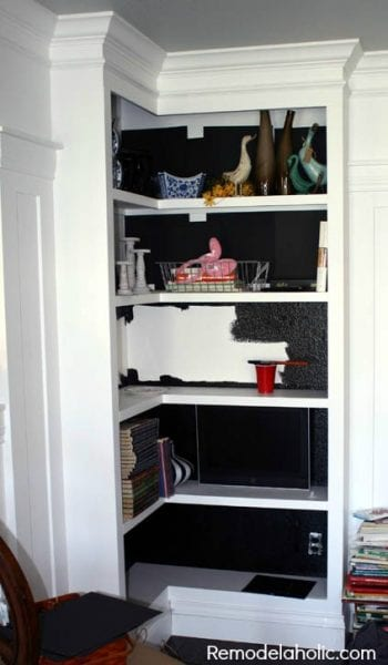 paint bookcase backings black to add depth and drama @Remodelaholic