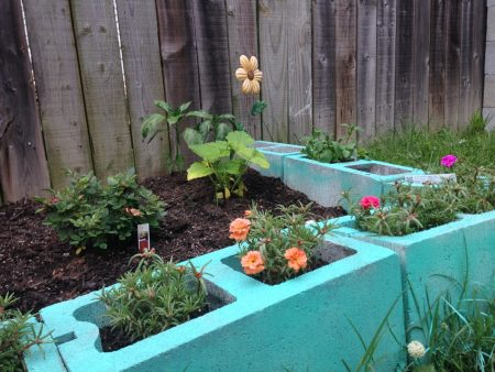 Use colorful painted cinderblocks for garden edging and plants featured on Remodelaholic.com