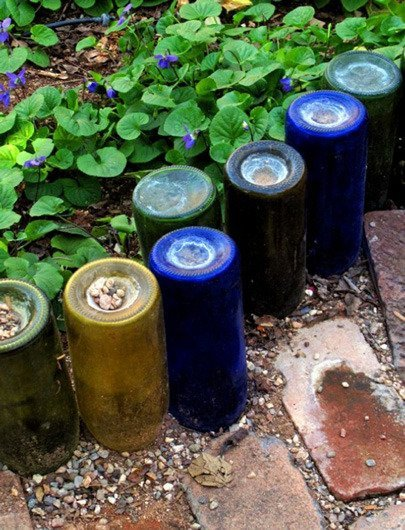 Use colorful old wine bottles for a unique recycled garden edging featured on Remodelaholic.com