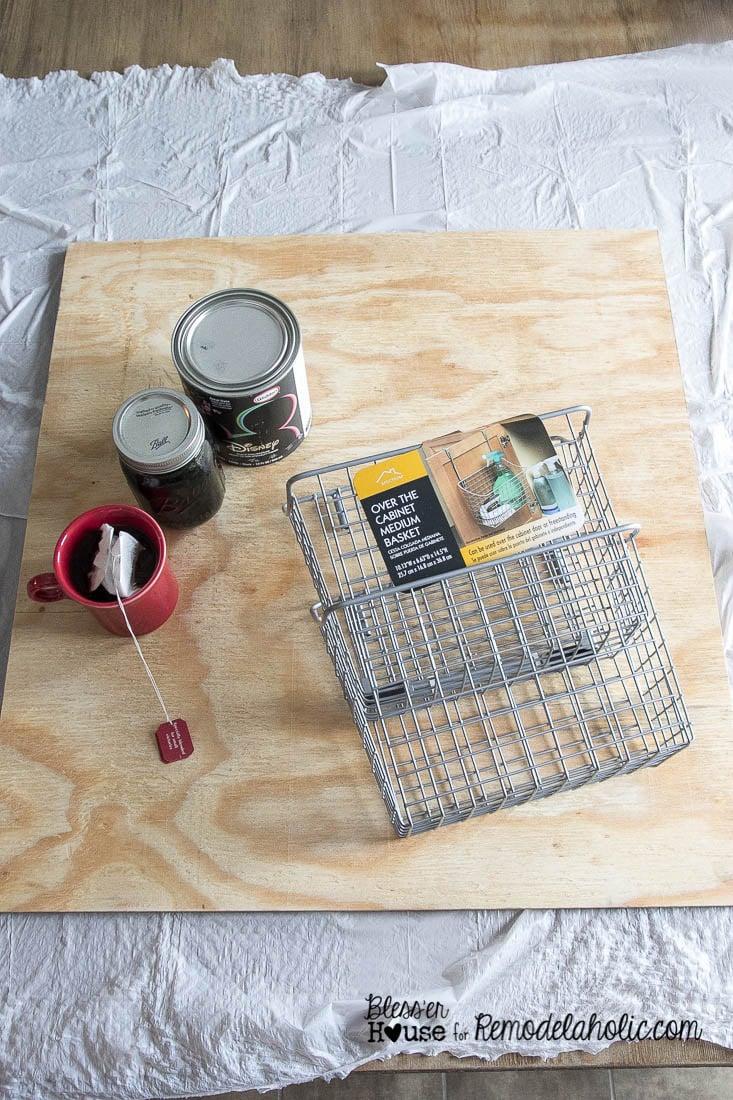 DIY Locker Basket Mail Organizer -- homemade wood stain, easy painted chalkboard, plus cheap Walmart baskets makes a great mail organizer!