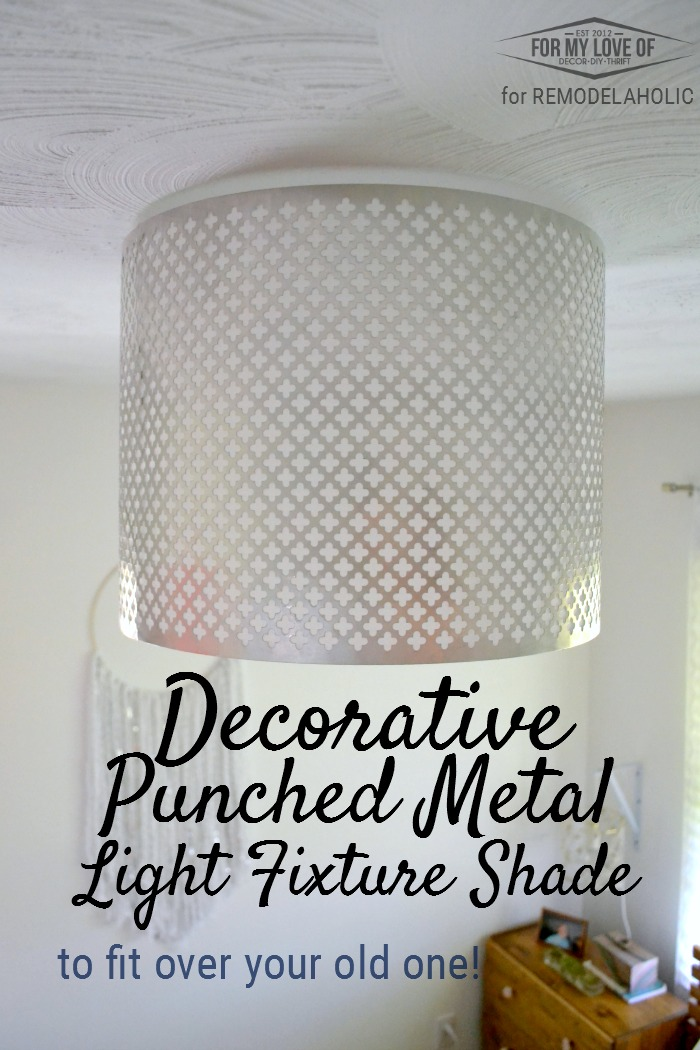 Dress up a basic builder grade light with a DIY punched metal ceiling light  shade,