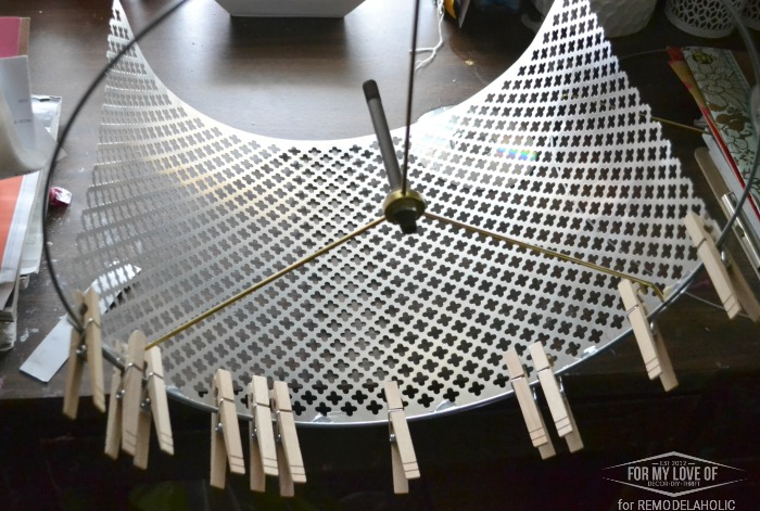 USE CLOTHESPINS TO CONNECT THE SHEET OF METAL TO THE LAMP RINGS