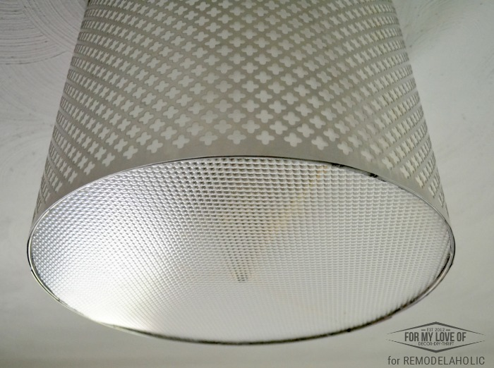 ceiling light panel disguises the innerds of the old and ugly light fixture