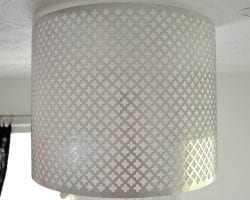 decorative punched metal lamp shade retrofitted over an existing light fixture
