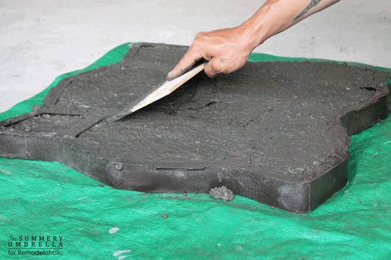 make your own rocks from concrete for a DIY waterfall feature