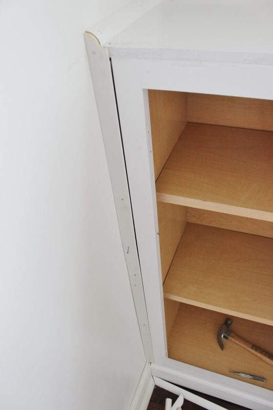 Cutom Storage with Built-In Cabinets for Playroom by Delightfully Noted featured on Remodelaholic
