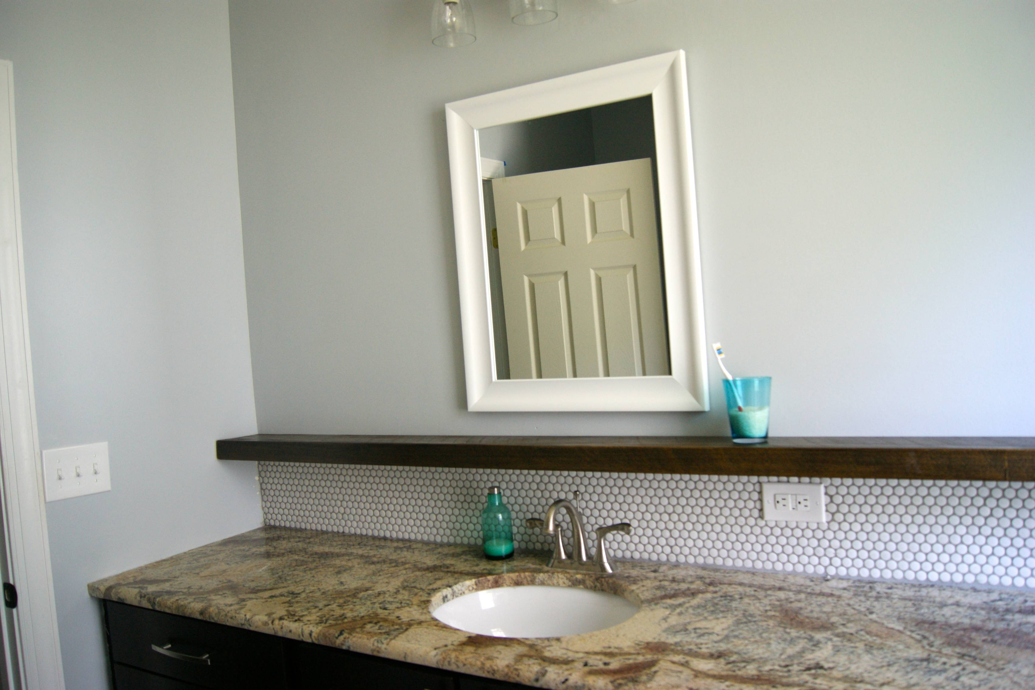 Diy bathroom tile - Bathroom Makeover With Penny Tile And Floating Wood Shelf