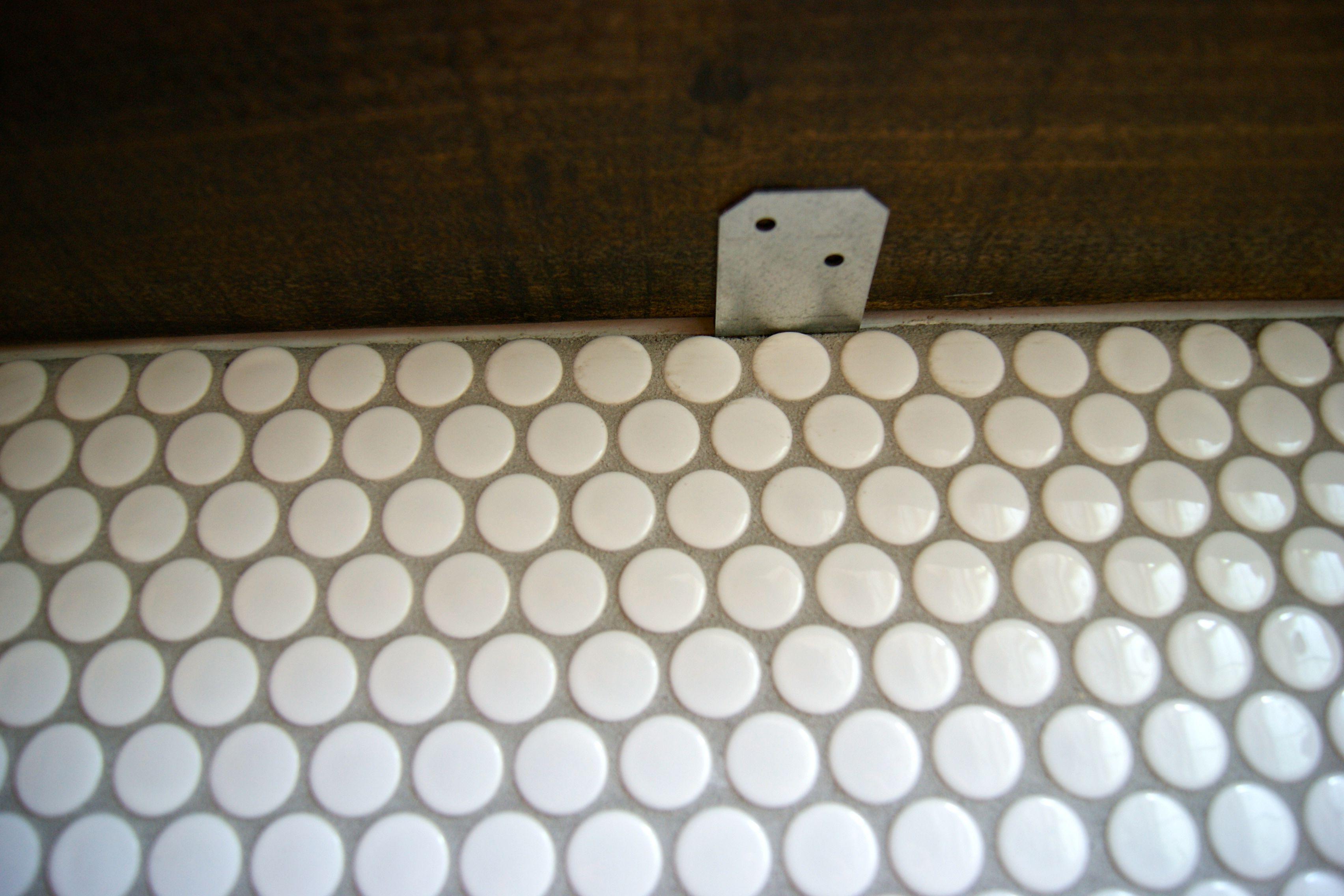 tips for installing a penny tile backsplash floating shelf