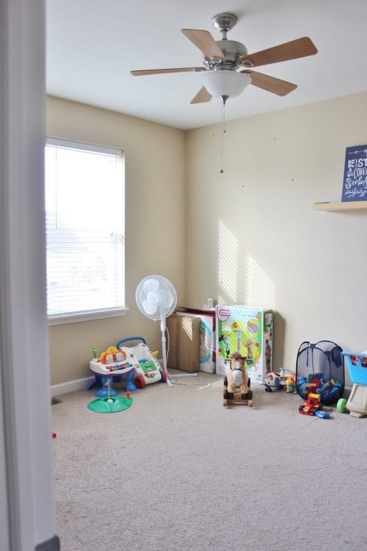 Playroom Makeover with Built-In Cabinets Before by Delightfully Noted featured on Remodelaholic