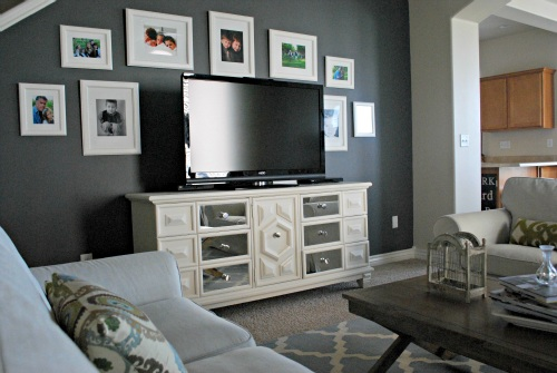 TV gallery wall, dark wall with light frames to hide the television (via Design Mom)