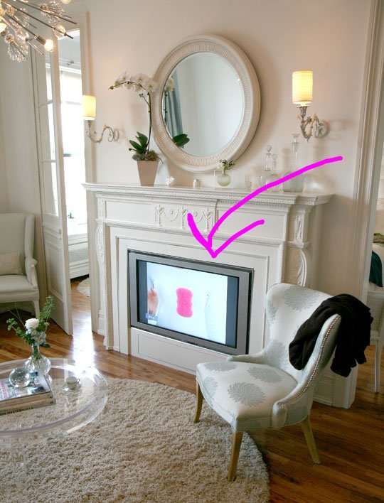 build a faux mantel to hide the TV (via Apartment Therapy)