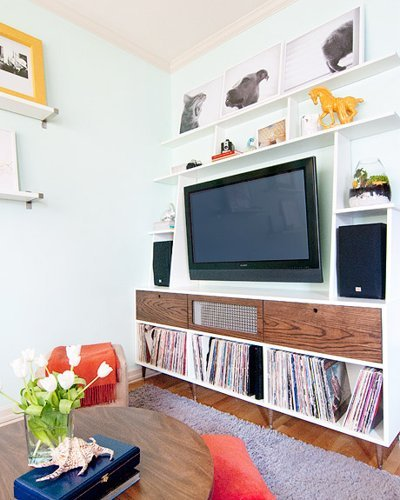 built-in storage and shelving around the TV (via Apartment Therapy)