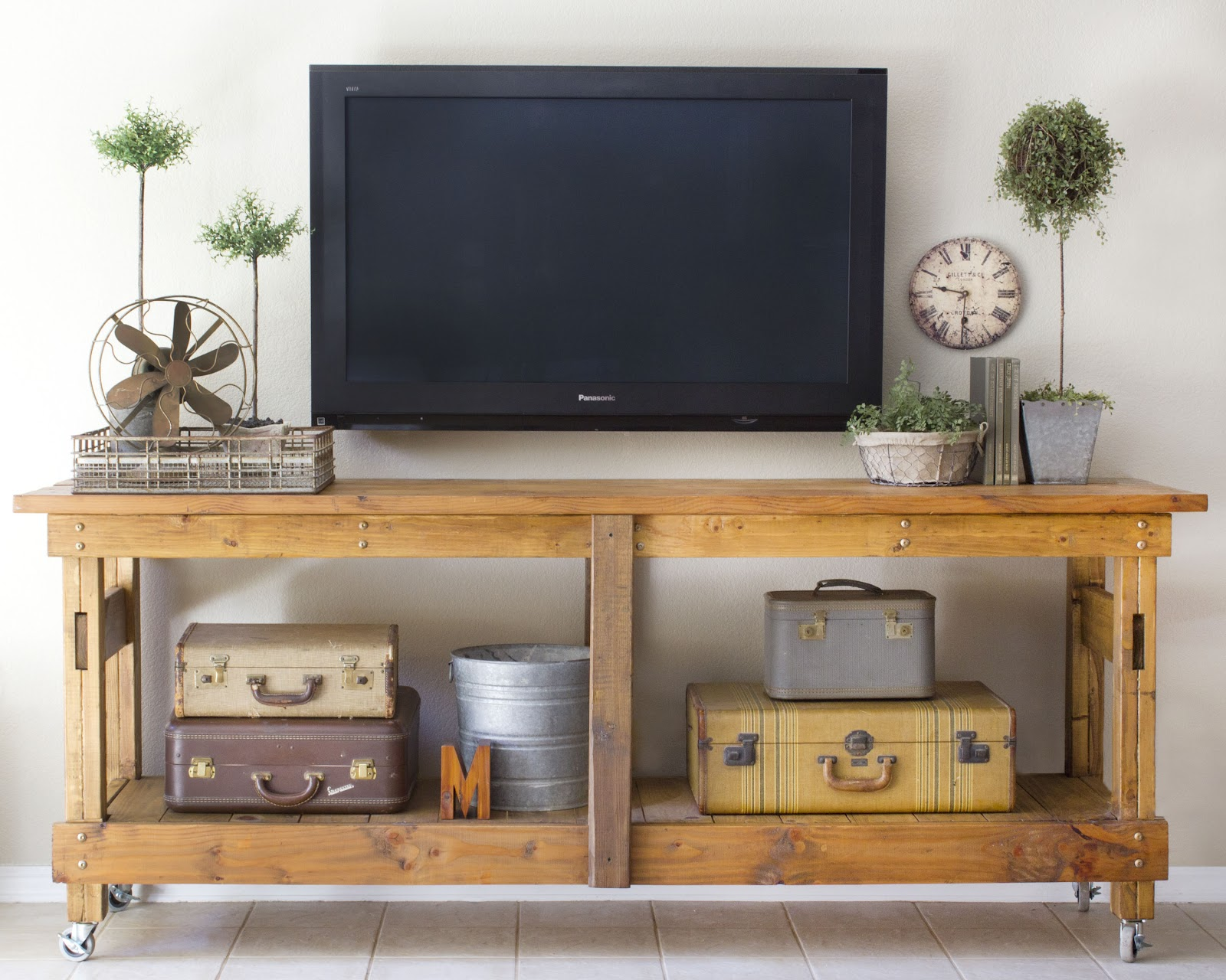 ... decorate around the TV with a workbench console and minimal decor  (Brooklyn Limestone)
