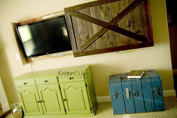 diy sliding barn door cover to hide the television (Kristen Duke Photography)
