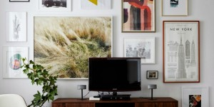 feature large art gallery wall to hide a TV (Cup of Jo)