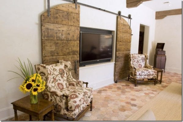 full height barn doors to slide over a recessed television (via Cote de Texas)